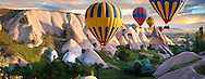 Hot Air Baloons over Goreme at sunrise , Cappadocia Turkey .<br /> <br /> If you prefer to buy from our ALAMY PHOTO LIBRARY  Collection visit : https://www.alamy.com/portfolio/paul-williams-funkystock/cappadocia-balloons.html<br /> <br /> Visit our TURKEY PHOTO COLLECTIONS for more photos to download or buy as wall art prints https://funkystock.photoshelter.com/gallery-collection/3f-Pictures-of-Turkey-Turkey-Photos-Images-Fotos/C0000U.hJWkZxAbg