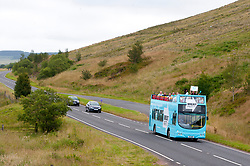 © Licensed to London News Pictures. 27/07/2019. Brecon, Powys, Wales, UK. The Brexit Party bus travels through the BreconBeacons as Des Parkinson, retired former Welsh police chief superintendent and Brexit Party candidate for the Brecon & Radnorshire constituency, continues his campaign in Mid Wales to win the seat in the forthcoming by-election on 1st August 2019.<br /> The by-election has been recalled because the incumbent Tory MP Chris Davies has been booted from the seat after a recall petition was passed when more than 10,000 voters backed the move. <br /> The Brexit Party was founded by former UKIP economics spokeswoman, Catherine Blaiklock in January 2019, and is led by Nigel Farage. The Brexit party has 29 Members of the European Parliament (MEPs) and four Welsh Assembly Members. The party's first major electoral success was winning the 2019 European Parliament election in the United Kingdom after four months in existence. Photo credit: Graham M. Lawrence/LNP