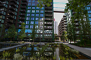 """London, United Kingdom, Jun 2, 2021: General pictures show a 25-metre sky pool in Embassy Gardens linking two residential buildings in London's Nine Elms, floating 10 storeys above ground. The Sky Pool, described as """"the world's first floating pool"""", is only open to some of the development's residents, where rent is from about £1,800 to £6,500 per month. (Photo by Vudi Xhymshiti"""