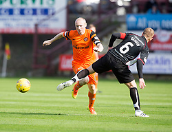 Dundee United's Willo Flood  and Dunfermline's Andy Geggan. half time : Dunfermline 0 v 1  United, Scottish Championship game played 10/9/2016 at East End Park.