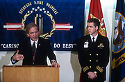 WASHINGTON, DC, USA - 1997/03/14: White House spokesman Mike McCurry, left, briefs reporters alongside Dr. David Wade on the upcoming surgery for President Bill Clinton at National Naval Medical Center March 14, 1997 in Bethesda, Maryland. The president will undergo knee surgery to repair a torn tendon after tripping on stairs at the home of golfer Greg Norman.  (Photo by Richard Ellis)