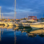 Early morning light on boats docked in a marina in Rockland, Maine