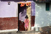 A Hindu young girl is praying in front of her home in the early morning in Bhopal, Madhya Pradesh, near the former Union Carbide (now DOW) industrial complex.
