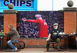 A Manchester United fan sits outside Old Trafford infront of a Wayne Rooney graphic - Mandatory by-line: Matt McNulty/JMP - 17/09/2017 - FOOTBALL - Old Trafford - Manchester, England - Manchester United v Everton - Premier League