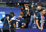 Kylian Mbappe of PSG having difficulties with his crutches, French President Emmanuel Macron, President of French Football Federation (FFF) Noel Le Graet during the trophy ceremony following the French Cup final football match between Paris Saint-Germain (PSG) and AS Saint-Etienne (ASSE) on Friday 24, 2020 at the Stade de France in Saint-Denis, near Paris, France - Photo Juan Soliz / ProSportsImages / DPPI