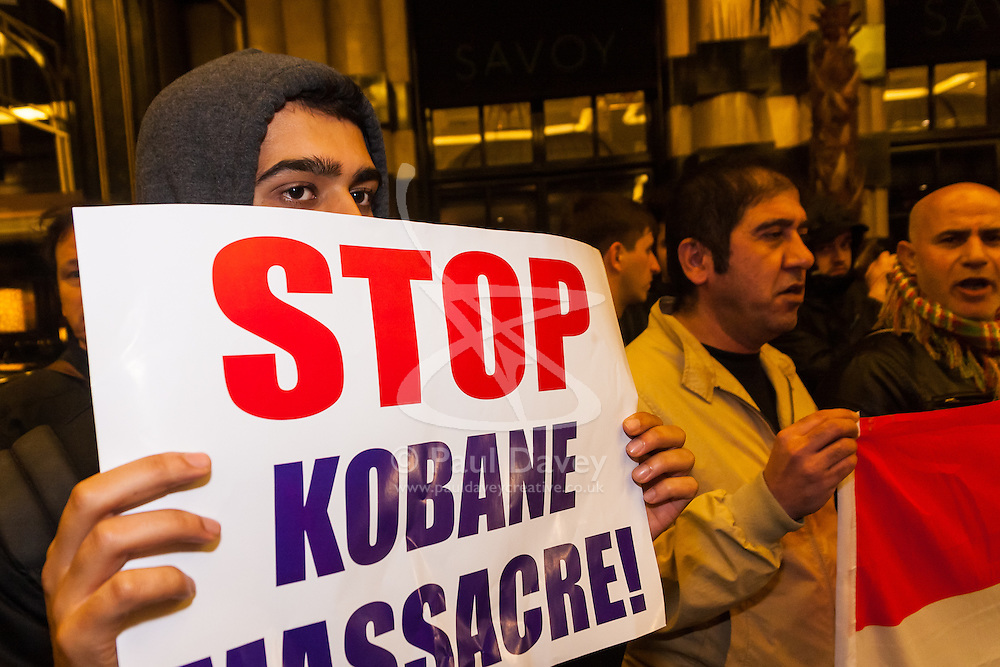 """London, October 25th 2014. Dozens of Britain's Kurdish community and their supporters demonstrated outside the exclusive Savoy as Turkey's ambassador welcomed guests to a ball. The Kurds accuse Turkey of helping Jihadists from ISIS in eradicating Kurds, who have held a long campaign for an autonomous Kurdish state. Pictured: Kurds believe that Turkey is surreptitiosly supporting ISIS in their conflict with the Kurds, and that the """"massacre"""" in Kobane could be stopped by a more assertive Turkey."""