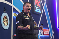 Gary Anderson wins his first round match against Ryan Searle during the PDC William Hill World Darts Championship at Alexandra Palace, London, United Kingdom on 23 December 2019.