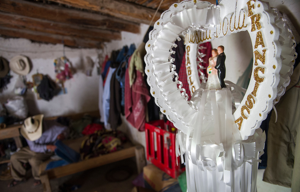 """This July 26, 2016 photo shows a hanging wedding centerpiece displayed in the home of newlyweds Pablo Ibarra, 75, and Francisca Santiago, 65, in Santa Ana, in the Mexican state of Oaxaca. The couple first met in 1967 while tending goats in the fields outside of Santa Ana. Soon thereafter Ibarra asked Santiago to marry him. But Santiago, who was 16 at the time, said she turned down his first offer """"out of respect"""" for her widowed mother. NICK WAGNER / ASSOCIATED PRESS"""