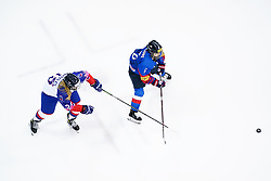 Great Britain's Isabell Whiteley (left) and Republic of Korea's Choi Yoo-jung battle for the puck during the Beijing 2022 Olympics Women's Pre-Qualification Round Two Group F match at the Motorpoint Arena, Nottingham.