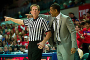 DALLAS, TX - JANUARY 4: Connecticut Huskies head coach Kevin Ollie has words with an official against the SMU Mustangs on January 4, 2014 at Moody Coliseum in Dallas, Texas.  (Photo by Cooper Neill) *** Local Caption *** Kevin Ollie