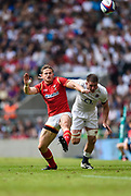 Wales' Hallam Amos chase his kick through as Teimana Harrison gives chase during the The Old Mutual Wealth Cup match England -V- Wales at Twickenham Stadium, London, Greater London, England on Sunday, May 29, 2016. (Steve Flynn/Image of Sport)