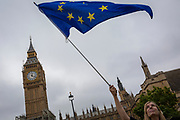 Pro-Europe protesters display the EU flag in front of Parliament after the last chimes of Big Ben were controversially silenced by the repair project that is scheduled to be completed by 2021, on 21st August 2017, in London, England.