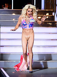 EDITS NOTE NUDITY Courtney Act enters the house during the Celebrity Big Brother Men's Launch held at Elstree Studios in Borehamwood, Hertfordshire.