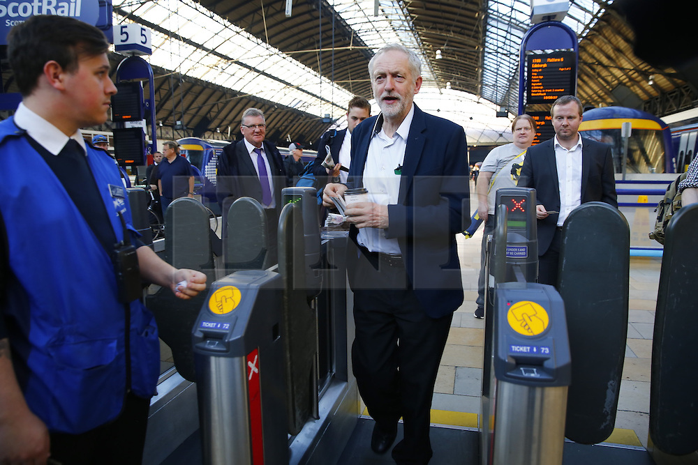 © Licensed to London News Pictures. 01/10/2015. Glasgow, UK. Leader of Labour Party JEREMY CORBYN arriving Glasgow Queen Street station after travelling between Edinburgh and Glasgow on a ScotRail train on Thursday, 1 October 2015 whilst making his first visit to Scotland as leader of the UK Labour Party. Photo credit: Tolga Akmen/LNP