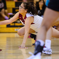 Tohatchi Cougar Delicia Begay (10) dives to shave a shot from the Navajo Prep Eagles Thursday at Tohatchi High School.