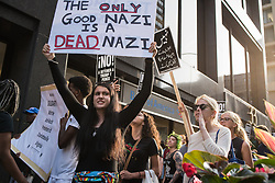 August 15, 2017 - Chicago, Illinois, United States - Demonstrators march towards Trump International Hotel and Tower Chicago in solidarity with the victims of the recent racist violence in Charlottesville. People across the country continue to mourn the loss of demonstrator H. Heyer and those injured when a car ran into a protest against white nationalists in Charlottesville, Va and are critical of President Trump's vague response to the incident. (Credit Image: © Max Herman/NurPhoto via ZUMA Press)
