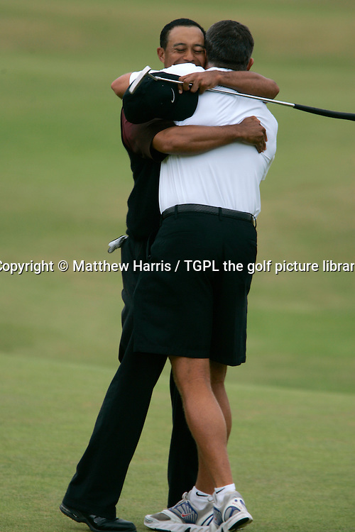 Tiger WOODS (USA) hugs his caddie Steve Williams after victory at 18th during fourth round The Open Championship 2005,St Andrews Old Course,St Andrews,Fife,Scotland.