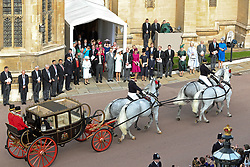 Queen Elizabeth II and the Duke of Edinburgh with members of the Royal Family wave to Princess Eugenie and her new husband Jack Brooksbank, as they leave St George's Chapel in Windsor Castle following their wedding.
