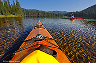 Kayaking on Big Therriault Lake in the Ten Lakes Scenic Area of the Kootenai National Forest, Montana, USA model released