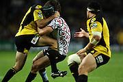 Berrick Barnes tackled by Conrad Smith<br /> Super 14 rugby union match, Waratahs vs Hurricanes, Sydney, Australia. <br /> Saturday 14 May 2010. Photo: Paul Seiser/PHOTOSPORT