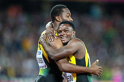 London, 2017 August 07. Omar McLeod, Jamaica, celebrates his victory with fellow countryman Hansle Parchment, in the Men's 110m hurdles final on day four of the IAAF London 2017 world Championships at the London Stadium. © Paul Davey.