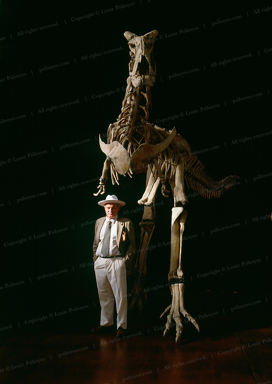 """Jose Bonaparte with Carnotaurus the """"meat-eating bull,"""" predator from the Argentina at the Museo de Ciencias Naturales de Buenos Aires."""