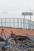 Mechanical diggers take part in the demolition of the  National Stadium, Shinjuku, Tokyo, Japan. Friday March 6th 2015. Large scale demolition work officially began, March 5th to remove  the old stadium, which was the venue for the 1964 Olympics, after many delays. Construction of the new Olympic stadium for the 2020 games is scheduled to begin in October 2015
