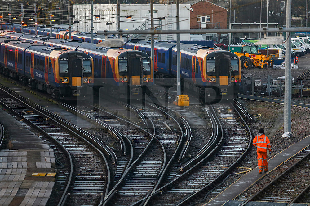 © Licensed to London News Pictures. 02/12/2019. London, UK. Sidelined. Trains remain in sidings as Commuters queue on platforms on the first day of the South Western Railway strike at Clapham Junction. RMT union have announced industrial action which will effect South Western Railway services for the next 27 days, until 02 January 2020. Photo credit: Alex Lentati/LNP