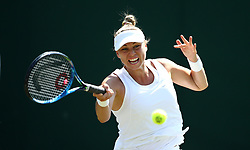 Vera Zvonareva in action on day two of the Wimbledon Championships at the All England Lawn Tennis and Croquet Club, Wimbledon.