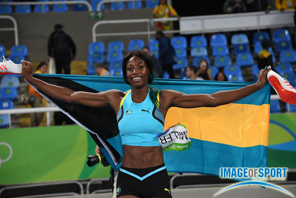 Aug 15, 2016; Rio de Janeiro, Brazil; Shaunae Miller (BAH) poses with flag after winning the women's 400m in 49.44 at Estadio Olimpico Joao Havelange in the Rio 2016 Summer Olympic Games.