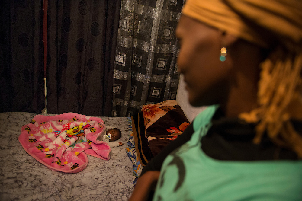 10 years ago, on 27 October 2005 riots broke out in the French suburbs.  It started here with the death of two boys, in Clichy-sous-Bois, 15 km from Paris, an economically deprived suburb. Keita Konate 23 years and her baby Asa 8 month. The family rents  one room of 9 m2 for 450 euros a month.  22 January 2015, Clichy sous Bois, France.