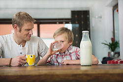Father and son drinking milk