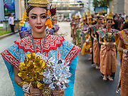 "14 JANUARY 2015 - BANGKOK, THAILAND: Women in formal Thai dance costumes march in the 2015 Discover Thainess parade. The Tourism Authority of Thailand (TAT) sponsored the opening ceremony of the ""2015 Discover Thainess"" Campaign with a 3.5-kilometre parade through central Bangkok. The parade featured cultural shows from several parts of Thailand. Part of the ""2015 Discover Thainess"" campaign is a showcase of Thailand's culture and natural heritage and is divided into five categories that match the major regions of Thailand – Central Region, North, Northeast, East and South.     PHOTO BY JACK KURTZ"