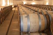 Oak barrel aging and fermentation cellar. Chateau Guiraud, Sauternes, Bordeaux, France