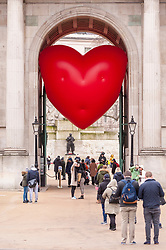"""© Licensed to London News Pictures. 14/02/2018. LONDON, UK. A giant chubby heart balloon is seen at Wellington Arch as part of """"Chubby Hearts Over London"""",  a design project conceived by Anya Hindmarch.  Supported by the Mayor of London, the British Fashion Council and the City of Westminster giant chubby heart balloons will be suspended over (and sometimes squashed within) London landmarks as a declaration of love to the city starting on Valentine's Day and continuing throughout London Fashion Week.   Photo credit: Stephen Chung/LNP"""