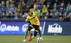 March 1, 2018 - Seattle, Washington, U.S - Soccer 2018: Seattle forward WILL BRUIN (17) works against defender YOSIMAR QUINONES (23) as Santa Tecla FC visits the Seattle Sounders for a CONCACAF match at Century Link Field in Seattle, WA. (Credit Image: © Jeff Halstead via ZUMA Wire)