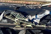 Nederland, Zuid-Holland, Rotterdam, 18-02-2015; Eerste Maasvlakte met aan de Mississippihaven Europees Massagoed Overslagbedrijf (EMO). Gespecialiseerd in de overslag van kolen en ijzererts. Kolentreinen worden beladen.<br /> In de achtergrond de containerterminal APM Terminals.<br /> EMO transhipment terminal for coal and iron ore and other dry bulk.<br /> luchtfoto (toeslag op standard tarieven);<br /> aerial photo (additional fee required);<br /> copyright foto/photo Siebe Swart