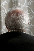 back view portrait of an 80 + year of age man