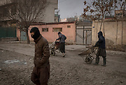 Men from an internally displaced camp within the city start their day's work collecting plastic to sell for burning and heating homes, Kabul, Afghanistan, February 3, 2020. Many cannot afford electricity and so burn coal, garbage, plastic and rubber in their homes to keep warm during the cold winter months. Old vehicles and generators that run on poor quality fuel release vast amounts of toxins into the city's air, exasperating the pollution problem in Kabul and through other cities in Afghanistan.