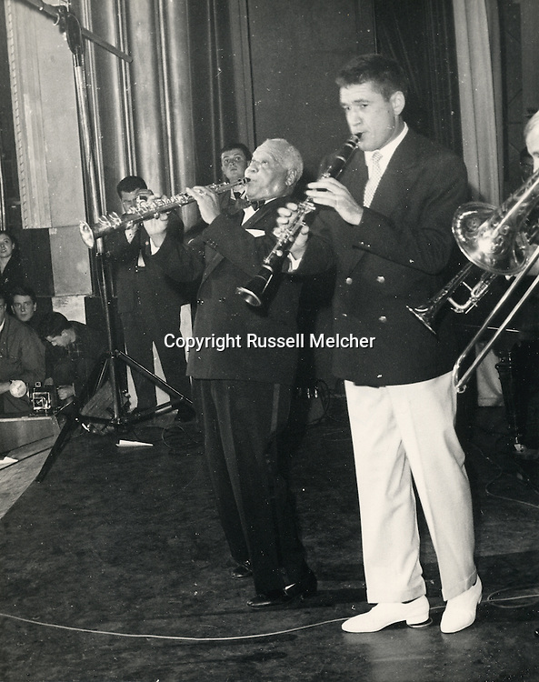Sidney Bechet and Claude Luter giving a free concert in the Olympia Music Hall in Paris, November 1955.<br /> So many people tried to get in in the Olympia, it caused riots in front of the theater.<br /> <br /> Sidney Bechet et Claude Luter donnant un concert gratuit à l'Olympia Music Hall à Paris , Novembre 1955.<br /> Tant de gens ont essayé d'entrer, cela a provoqué des émeutes devant le théâtre.