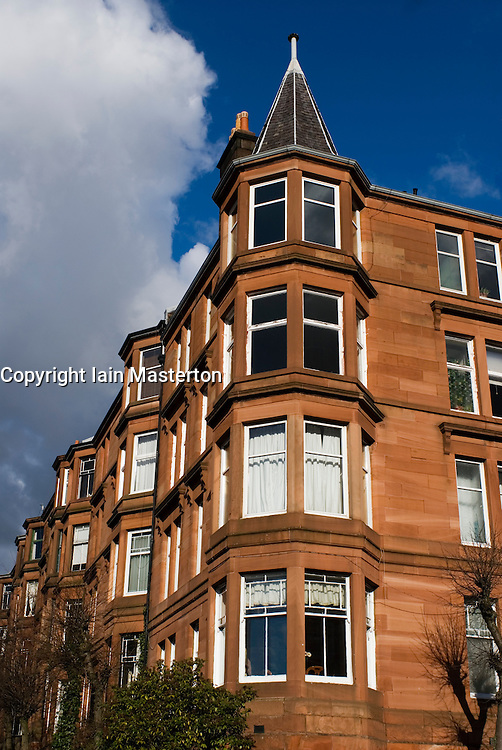 Traditional old red sandstone tenement apartment building in Glasgow Scotland