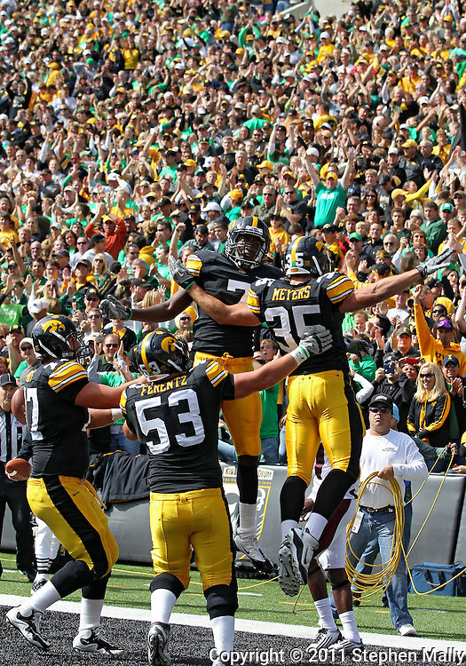 September 24, 2011: Iowa Hawkeyes wide receiver Marvin McNutt (7) and Iowa Hawkeyes fullback Matthew Meyers (35) celebrate McNutt's 13 yard touchdown catch as Iowa Hawkeyes offensive linesman Riley Reiff (77) and Iowa Hawkeyes offensive linesman James Ferentz (53) look on during the first quarter of the game between the Iowa Hawkeyes and the Louisiana Monroe Warhawks at Kinnick Stadium in Iowa City, Iowa on Saturday, September 24, 2011. Iowa defeated Louisiana Monroe 45-17.