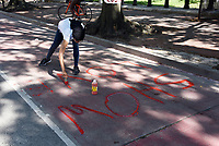 """June 12 + 13, 2020. Chelsea Enix painting """"Show Love"""" along H Street NW, which borders Lafayette Square and the White House. Two weeks after peaceful protesters were teargassed, the nation's capital remains on edge, those in power unwilling to confront either a racist past or an equitable future. In yellow letters 35 feet high, the street that spans two blocks between K Street NW and the White House has been renamed Black Lives Matter Plaza NW, an effort seen around the world. The area has become a pilgrimage spot for thousands of people supporting civil rights."""