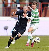 07/02/15 WILLIAM HILL SCOTTISH CUP 5TH RND<br /> DUNDEE v CELTIC<br /> DENS PARK - DUNDEE<br /> Dundee's James McPake (left) tussles with Stefan Johansen