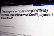 In this photo illustration, a laptop screen shows a notice to a benefits recipient that the temporary coronavirus COVID-19 increase to their Universal Credit payment will be removed by the end of September on 5th September, 2021 in Leeds, United Kingdom. British Chancellor Rishi Sunak is set to remove the £20 a week uplift to Universal Credit recipients in a move that critics have said will force the countrys poorest further into poverty.