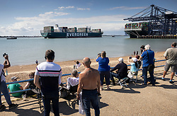 © Licensed to London News Pictures. 03/08/2021. Felixstowe, UK. People watch from the beach as the container ship 'Ever Given' arrives at the port of Felixstowe in Suffolk. The giant 400 metre long cargo ship became stuck in the Suez Canal in March causing worldwide delays to trade and was only released by the Egyptian authorities after an agreement was reached over a £655m compensation claim. Photo credit: Peter Macdiarmid/LNP