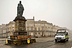 Police patrol vans pass statue of Robert Viscount Melville, Melville Street, Edinburgh, daubed with anti-slavery graffiti. pic by Terry Murden @edinburghelitemedia