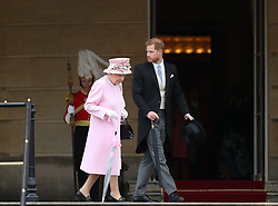 Queen Elizabeth II and The Duke of Sussex during a Royal Garden Party at Buckingham Palace in London.