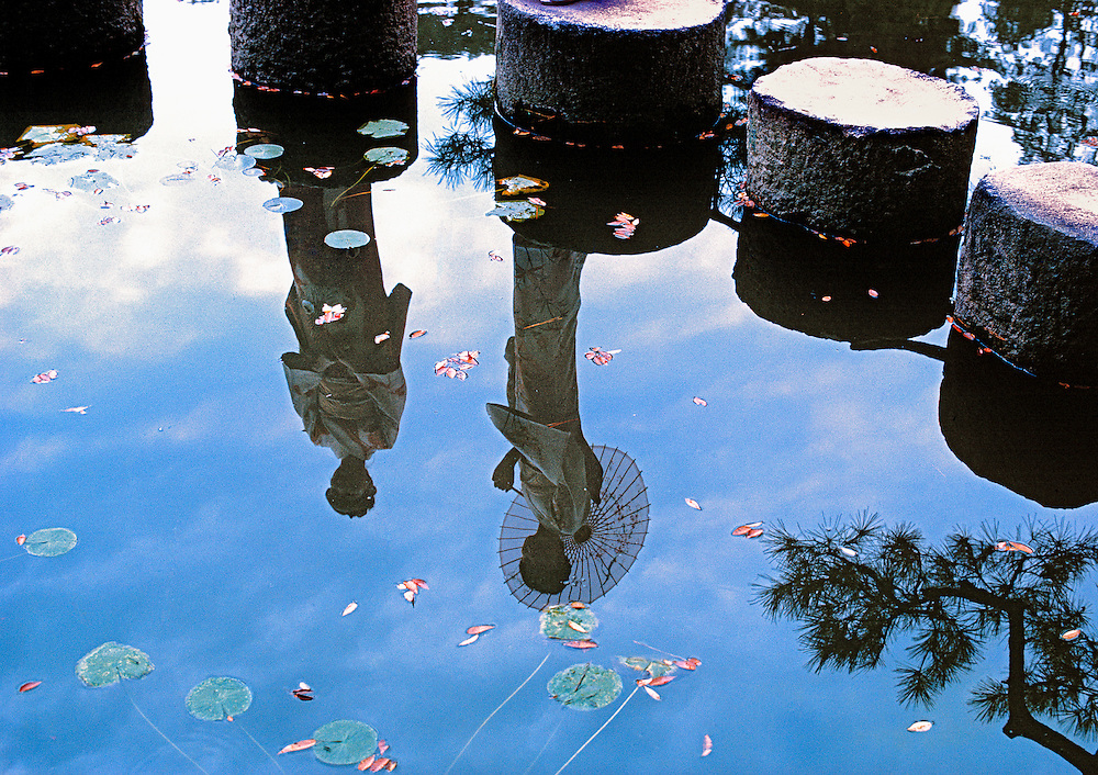 Formally-clad models pose on steps of a reflection pond at the Heian Shrine, Kyoto, Honshu, Japan.