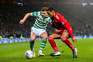 James Forrest (#49) of Celtic and Max Lowe (#29) of Aberdeen battle for possession of the ball during the Betfred Cup Final between Celtic and Aberdeen at Celtic Park, Glasgow, Scotland on 2 December 2018.